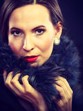 Fashion woman in fur coat, lady portrait. Fashion and beauty.  Woman in fur coat red lips and nails, lady retro style portrait on black background Royalty Free Stock Image