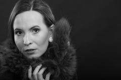 Fashion woman in fur coat, lady portrait. Fashion and beauty. Woman in fur coat, lady retro style portrait black white photo Stock Image