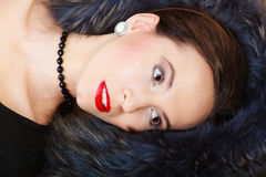 Fashion woman in fur coat, lady portrait. Fashion elegance and beauty. Woman in fur coat beautiful face makeup red lips, lady retro style portrait Royalty Free Stock Photography