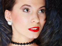 Fashion woman in fur coat, lady portrait. Fashion elegance and beauty. Woman in fur coat beautiful face makeup red lips, lady retro style portrait Stock Photos