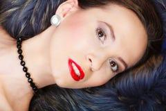 Fashion woman in fur coat, lady portrait. Fashion elegance and beauty. Woman in fur coat beautiful face makeup red lips, lady retro style portrait Stock Photo