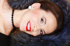 Fashion woman in fur coat, lady portrait. Fashion elegance and beauty. Smiling woman in fur coat beautiful face makeup red lips, lady retro style portrait Stock Images