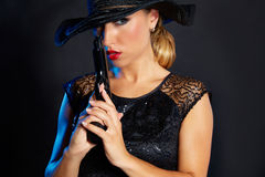 Fashion woman gangster style with handgun Stock Image