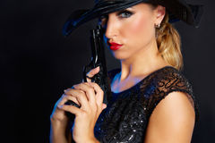 Fashion woman gangster style with handgun Stock Photo