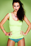 Fashion woman on the green background Royalty Free Stock Photography
