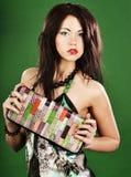 Fashion woman on green background Royalty Free Stock Photo