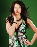 Fashion woman on green background Royalty Free Stock Image