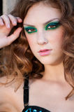 Fashion woman with green make-up at rural location Stock Photos