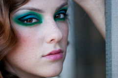 Fashion woman with green make-up at rural location Stock Image