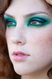 Fashion woman with green make-up at rural location Royalty Free Stock Photo