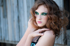 Fashion woman with green make-up at rural location Stock Images