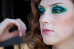 Fashion woman with green make-up at rural location Stock Photography
