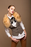 Portrait of Perfect Arrogant Woman in Grey Waistcoat and Fur Collar Stock Photography