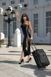 Fashion woman Hailing Taxi. In a hotel Royalty Free Stock Photo