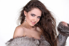 Fashion woman with hair style in fur coat Royalty Free Stock Image