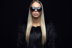 Fashion woman with hairy jacket and sunglasses Stock Photo