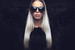 Fashion woman with hairy jacket and sunglasses Royalty Free Stock Image
