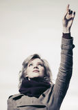 Fashion  woman with a hand pointing in the sky Stock Image