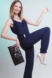 Fashion woman with handbag giving thumb up gesture. Elegant fashionable woman with leather handbag. Stylish girl holding black bag giving thumb up gesture. Women Stock Image