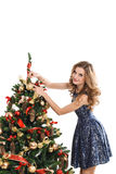 Fashion woman hanged a on the Christmas tree Royalty Free Stock Photo