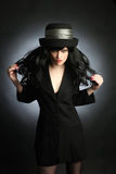 Fashion woman in hat brunette in black dress Royalty Free Stock Images