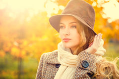 Fashion Woman in Hat on Yellow Autumn Background Royalty Free Stock Images