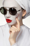 Fashion woman with healing skin mask Stock Photography