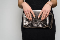 Fashion woman hold silver clutch in hand bag Royalty Free Stock Photo