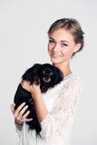 Fashion Woman holding Dog Royalty Free Stock Photos