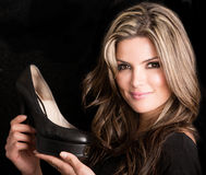 Woman holding shoes Royalty Free Stock Photo