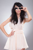 Fashion woman holds sunglasses Royalty Free Stock Photography