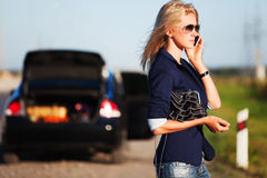 Fashion Woman In Sunglasses Calling On Mobile Phone Next To Broken Car Stock Photo