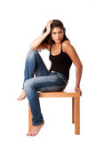 Fashion woman with jeans sitting Royalty Free Stock Photography