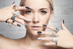 Fashion woman with jewelry and manicure Stock Image