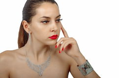 Fashion woman with jewelry. On white background Royalty Free Stock Photo
