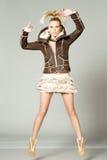 Fashion woman jumping Royalty Free Stock Photos