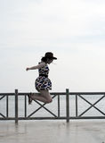 Fashion Woman Jumping at Seaside Royalty Free Stock Photo