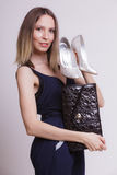 Fashion woman with leather handbag and high heels. Royalty Free Stock Image