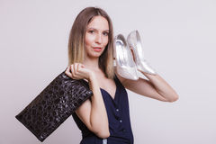 Fashion woman with leather handbag and high heels. Royalty Free Stock Photo