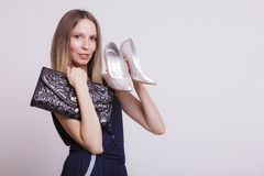 Fashion woman with leather handbag and high heels. Stock Photo