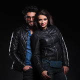 Fashion woman in leather jacket standing against her boyfriend Stock Images