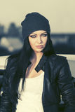 Fashion woman in leather jacket standing next to her car. Fashion punk woman in leather jacket standing next to her car Stock Photography