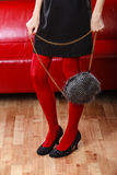Fashion woman legs in red tights handbag in hand Royalty Free Stock Photography