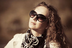Fashion woman with long curly hairs outdoor Royalty Free Stock Image