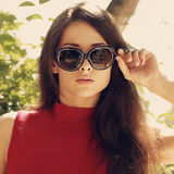 Fashion woman with long hair in modern sun glasses outdoors Royalty Free Stock Photos