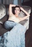 Fashion Woman. Lying on Sofa Royalty Free Stock Images