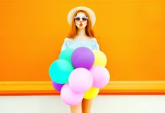 Fashion woman make an air kiss with an air colorful balloons Stock Images