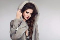 Fashion woman in mink fur coat, lady portrait. fashionable studi Stock Image