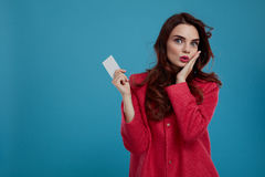 Fashion Woman Model Looking Surprised And Shocked Holding Card Royalty Free Stock Photography