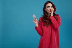 Fashion Woman Model Looking Surprised And Shocked Holding Card Stock Photography